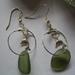 Dolphin and light green beachglass earrings