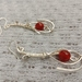 Wire wrapped sterling silver earrings with red carnelian