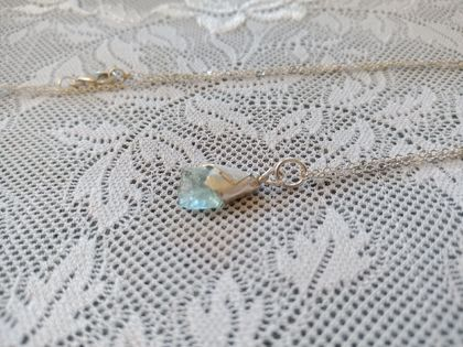 Sterling Silver necklace with rough aquamarine stone