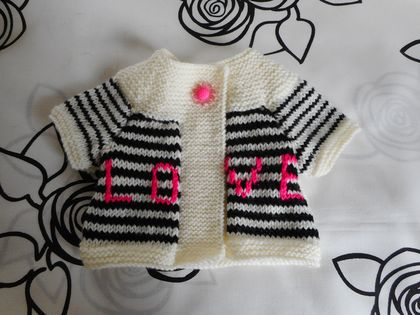 Cream. black and bright pink swing cardy