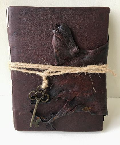 Handmade leather bound art, travel journal.