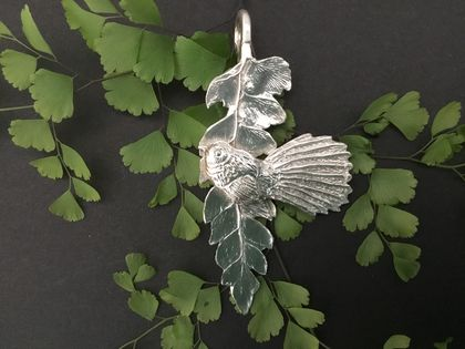 Handcrafted Silver Fantail on Fern Leaf