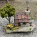 Miniature Miners Cottage with Green Tree and Cart
