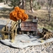 Miniature Stone Cottage with Water Wheel, Wagon and Orange Tree